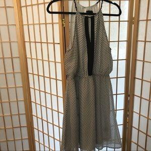 White sleeveless dress with black polka dots